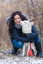 Girl with her dog breed siberian husky in winter Royalty Free Stock Photography