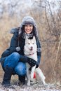 Girl with her dog breed siberian husky in winter Stock Images