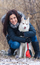 Girl with her dog breed siberian husky in winter Royalty Free Stock Photo