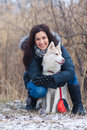 Girl with her dog breed siberian husky in winter Royalty Free Stock Images