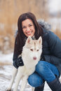 Girl with her dog breed siberian husky in winter Stock Photography