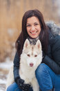 Girl with her dog breed siberian husky in winter Royalty Free Stock Photos