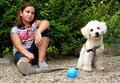 Girl and her dog in the garden Royalty Free Stock Photo