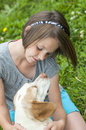 A girl and her dog looking lovingly at each other Stock Images