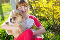 Girl with her dog on the nature nice spring time Royalty Free Stock Images