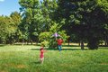 The girl and her father play with a kite dad devotes time to child Royalty Free Stock Photo