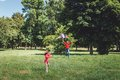 The girl and her father play with a kite dad devotes time to child Royalty Free Stock Photos