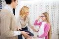 Girl and her mother likes blue framework for eyeglasses Royalty Free Stock Photo