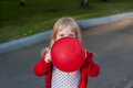 The girl is hiding behind the ball Royalty Free Stock Photo