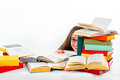 Girl hiding behind stack of colorful books Royalty Free Stock Photo