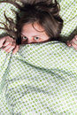 Girl hiding under blanket Royalty Free Stock Photography