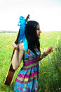 Girl hippie with guitar boho chic bohemian styl beautiful young woman of in blue violet dress blue stripe in the grass looking Stock Images