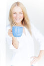 Girl hold blue cup of coffee