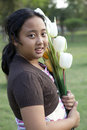 Girl hold bouquet of tulip flowers standing in ther garden Royalty Free Stock Photos