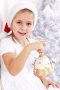 Girl hold Christmas bell Stock Photo