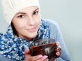 Girl hold hot cup of tea young woman in warm sweater colorful scarf white cap with big Stock Image