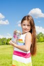 Girl hold jar with butterfly beautiful long dark hair years old standing in the field on bright sunny summer day Royalty Free Stock Images