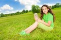 Girl hold jar with butterfly happy little sitting in the field in the park on sunny summer day Royalty Free Stock Photography