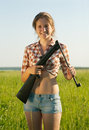 Girl holding  air rifle Royalty Free Stock Photo