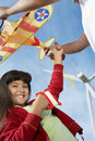 Girl Holding Airplane Kite At Wind Farm Royalty Free Stock Images