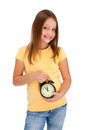 Girl holding alarm-clock isolated on white Royalty Free Stock Images