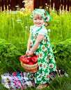Girl holding a basket of apples portrait Royalty Free Stock Image