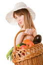 Girl holding a basket of  fresh vegetables. Stock Image