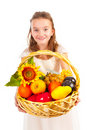 Girl holding basket full of fresh fruit Royalty Free Stock Photo