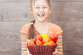 Girl holding a basket of juicy vegetables little Stock Photos