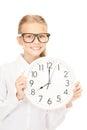 Girl holding big clock