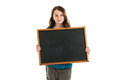 Girl holding blank chalkboard isolated on white Royalty Free Stock Images