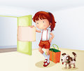 A girl holding a blank paper with a bag and a dog Royalty Free Stock Photo