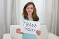 Girl Holding Board With The Text Thank You Royalty Free Stock Photo
