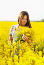 Girl holding a bouquet of yellow flowers with long hair Royalty Free Stock Images
