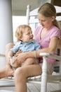 Girl holding boy toddler.