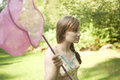 Girl Holding Butterfly Net Royalty Free Stock Photo