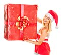 Girl holding christmas gift box woman in santa hat Royalty Free Stock Photo