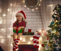 Girl holding Christmas gift Royalty Free Stock Photo