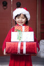 Girl Holding Christmas Gifts Royalty Free Stock Photo