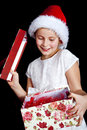 Girl holding christmas present Royalty Free Stock Image