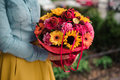 Girl holding colorful bouquet with different Gerbera flower Royalty Free Stock Photo