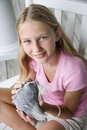 Girl holding conch shell. Stock Images