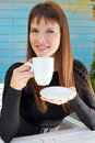 Girl holding a cup of drink and smiled pleasantly Royalty Free Stock Image