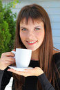Girl holding a cup of tea and smiled pleasantly Royalty Free Stock Photos