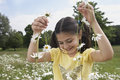 Girl Holding Daisy Chains In Meadow Royalty Free Stock Photo