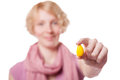 Girl holding easter egg in front of the cameras young woman a yellow isolated on white background Stock Images