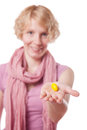 Girl holding easter egg in front of the cameras young woman a yellow isolated on white background Stock Photography