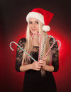 Girl holding fake candy cane cute blond young woman Royalty Free Stock Photos