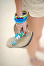 Girl holding flip-flops Royalty Free Stock Photography