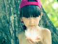 Girl holding flower caucasian kid on the tropical island Royalty Free Stock Photography